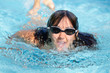 Woman swimming towards the camera