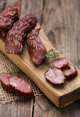 Dried sausage on kitchen plank