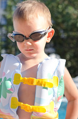 Little boy in swimming goggles on a hot summer day