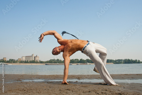 Acrobatic stunt on the beach