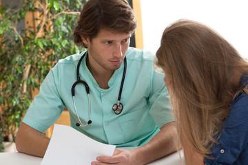 Doctor talking with hypochondriac