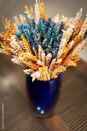 Colorful decorative vase with dried wheat