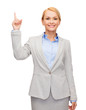 smiling businesswoman with her finger up