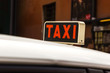 Close-up of a taxi sign on a taxi