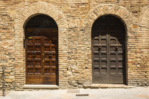Closed doors of a building in the medieval town of San Gimignano