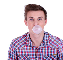 Young man blowing bubble of chewing gum isolated on white