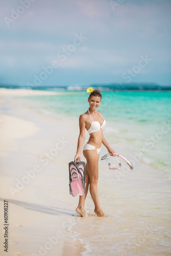 Portrait of young beautiful women on the sunny tropical beach
