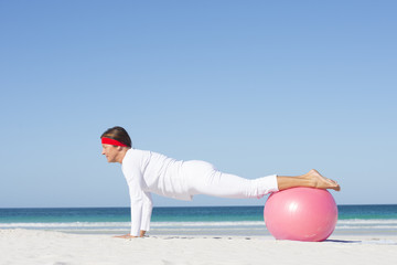 Mature woman yoga exercise beach