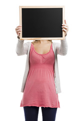 Beautiful blonde woman holding  a chalkboard