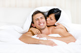 Close up of couple playing in bed
