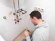Plumber repairing an electric boiler