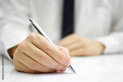 businessman is signing agreement