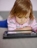 toddler girl using tablet pc