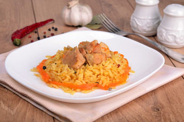 Pilaf with meat, pepper and garlic
