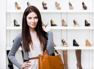 Portrait of woman in shopping center in the section of footwear