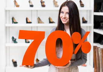 Woman keeps the model of 70% sale on shoes