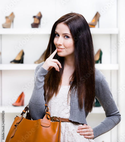 Portrait of woman in shopping center in the section shoes