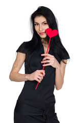 brunette in black dress with  heart made ​​of paper