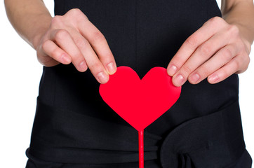 female hands holding heart out of pape