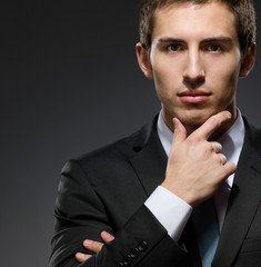 Portrait of pensive business man wearing business suit