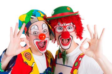 clowns machen handzeichen