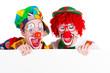 lachende clowns mit werbeschild