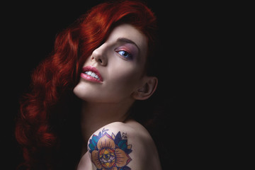 Sensual portrait of beautiful girl with tattoo