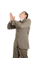 Portrait of a hispanic praying businessman