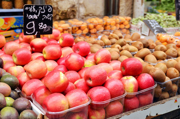 close up of apples on market stand