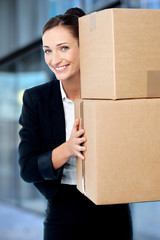 Female executive holding cardboard boxes