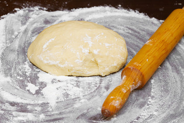 dough and wooden rolling pin