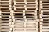 Stack of wooden pallets with selective focus