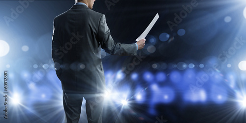 Business man on stage