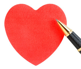 Paper sheet in the shape of a heart with pen isolated on white