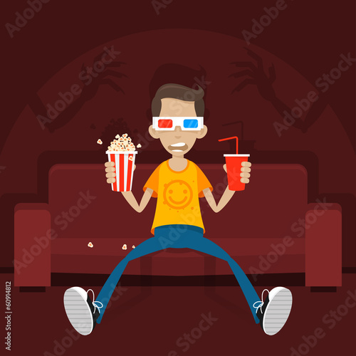 Teenager sits on sofa in 3D glasses