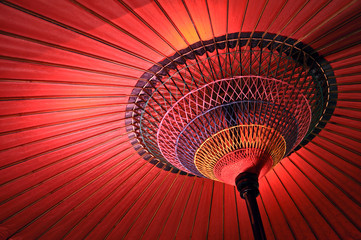 Red japanese umbrella © Delphotostock