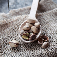 Dried Pistachio Nuts In A Wooden spoon