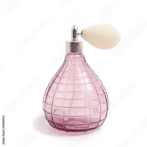 Vintage pink perfume spray bottle with pump on white background