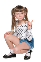 Young girl in polka dot blouse