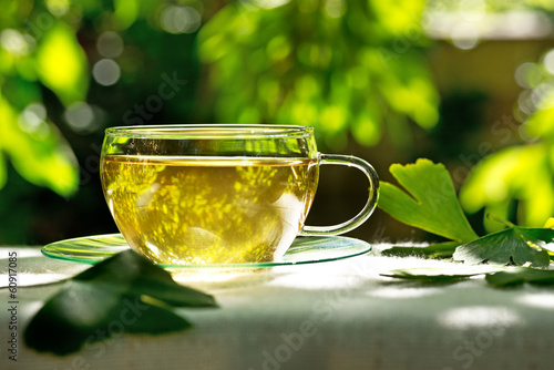 Leinwandbild Motiv tea with herbaceous plant