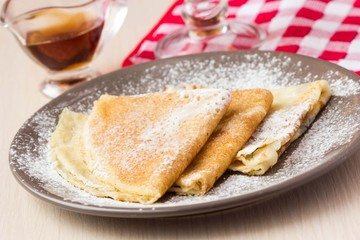 Thin sweet pancakes, powdered sugar for Breakfast, Shrovetide