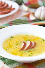 Cream soup of red lentil with smoked meat, duck, chicken