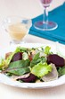 Fresh salad with lettuce leaves, boiled beef, beet, mustard