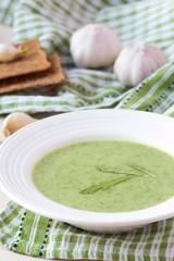 Green garlic cream soup with leaves rukola, arugula, healthy