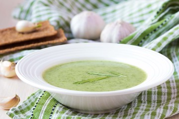 Green garlic cream soup, leaves rukola, arugula, healthy diet