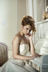 Beautiful girl in the image of the bride