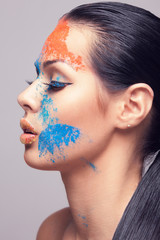 beautiful model with dry coloured powder