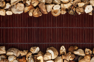 Dried mushroom on a dark  bamboo mat
