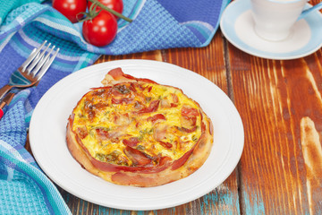 Breakfast Quiche. Smoked bacon, leek and roast garlic quiche