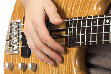 Close-up of a hand on a bass guitar